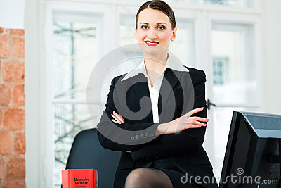 Lawyer in office with law book