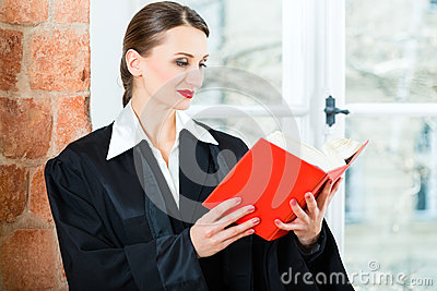 Lawyer in office reading law book
