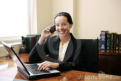 Lawyer on phone with laptop