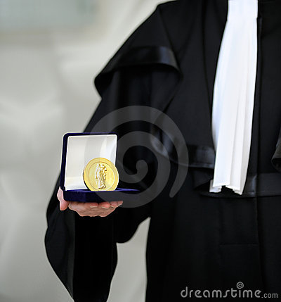 Lawyer wearing a robe holding a a justice meda