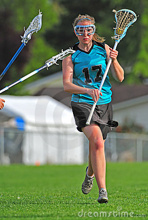 LAX player protecting the ball
