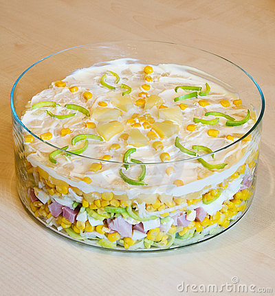 Layer salad on table