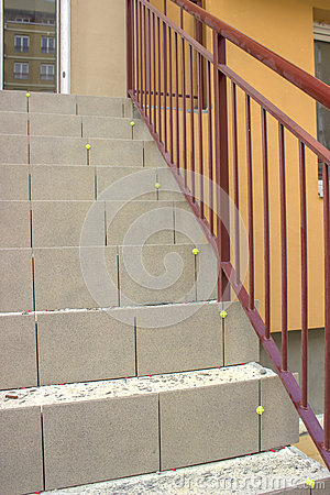 Laying ceramic tile on concrete stairs stock photo image - How to tile concrete stairs ...