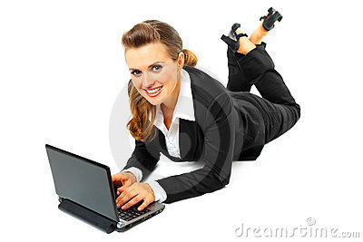 Laying on floor business woman using laptop