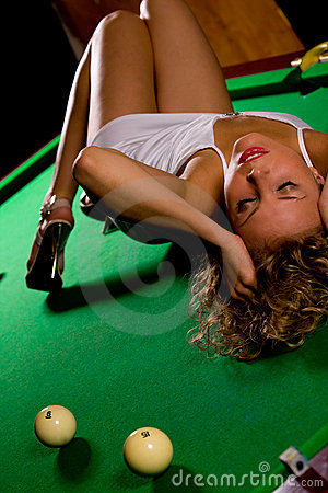 Laying on green snooker table