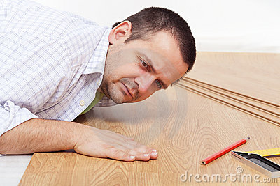 Laying laminate flooring at home