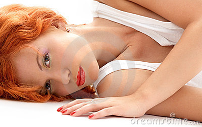 Laying redhead in white shirt
