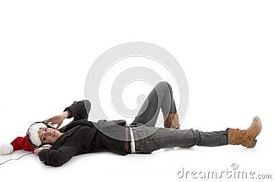 Laying woman wearing christmas hat