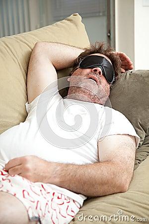 Lazy Man Asleep on Couch
