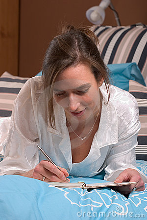 Lazy sunday afternoon writing in her diary