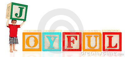 Le garçon avec l alphabet bloque JOYEUX
