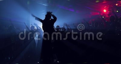 Leading, showman, works for the public. Silhouette. Dance master class. Group, lens flare stock video footage
