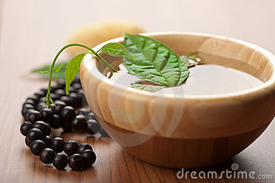 Leaf in wooden bowl and beads. zen background