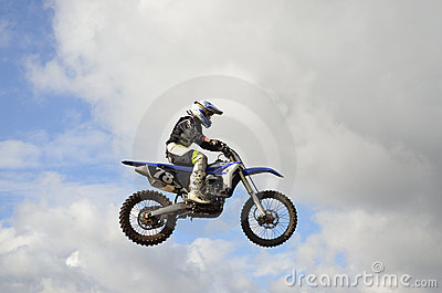 A leap over the hill motocross racer