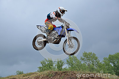 A leap over the hill motocross racer Editorial Photography