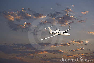Learjet 45 with Sunset Clouds