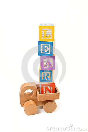 Learn written with play blocks on wooden toy truck