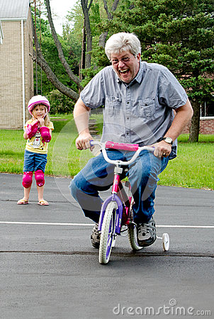 Free Learning To Ride A Bike With Training Wheels Royalty Free Stock Photography - 41076957