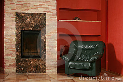 Leather armchair and fireplace