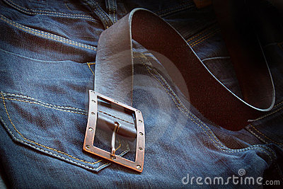 Leather belt over a pair of jeans