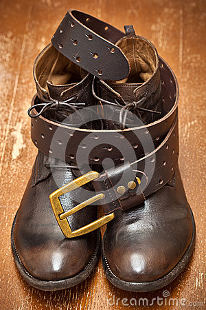 leather shoes and belt brown with gold buckle stock photo