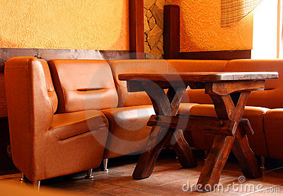 Leather sofa and wooden table