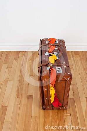 Leather suitcase with too much clothing