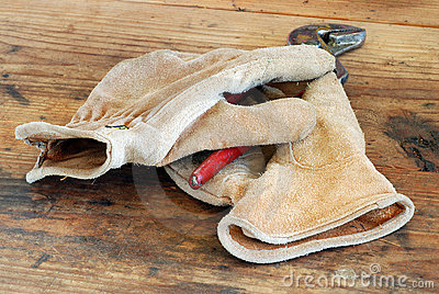 Leather Work Gloves and Pliers on Workbench