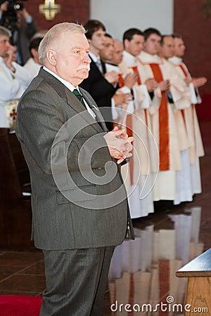Lech Walesa in church Editorial Photo