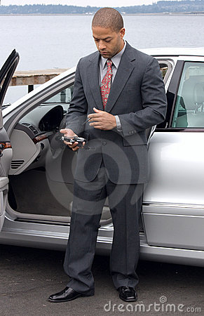 Free Left Handed Ethnic Business Man Using PDA Royalty Free Stock Images - 10500319
