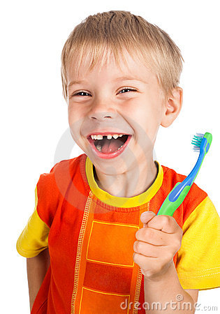 Left-handed smiley boy with toothbrush