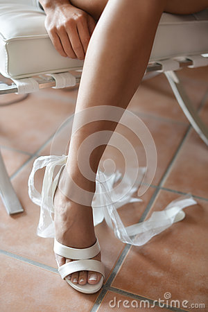 Leg of bride in white shoes