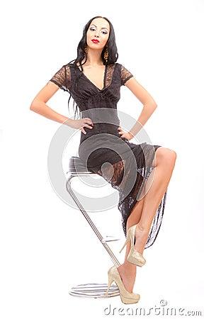 Leggy beauty in a high chair