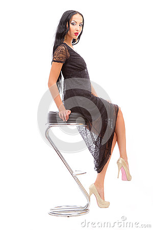 Leggy beauty in a high chair