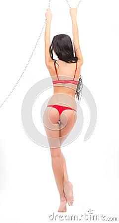 Leggy beauty in red underwear hanging