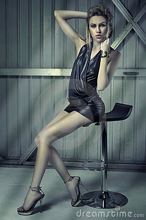 Leggy blonde on chair