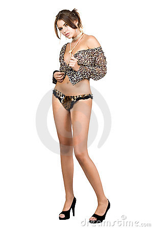 Leggy sexy young woman in leopard shirt