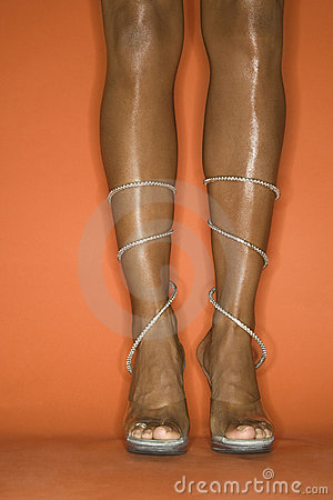 Free Legs And Feet Of Young African-American Woman Wearing High Heel Stock Photos - 2043973