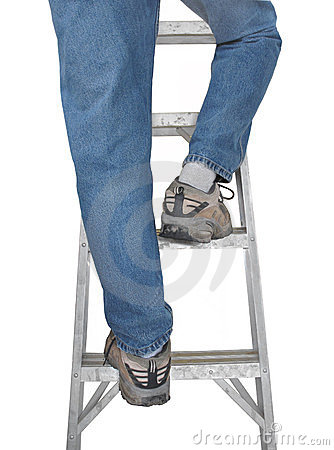 Legs in blue jeans on ladder isolated.