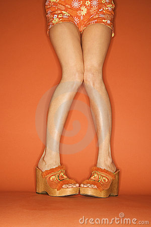 Legs and feet of Caucasian woman.