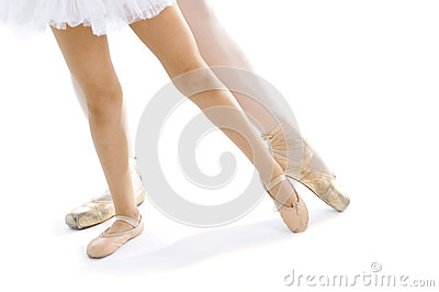 Legs and feet of classical Ballet dancer teacher and learning pupil training position