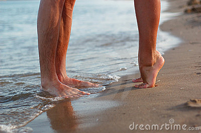 Legs of kissing couple