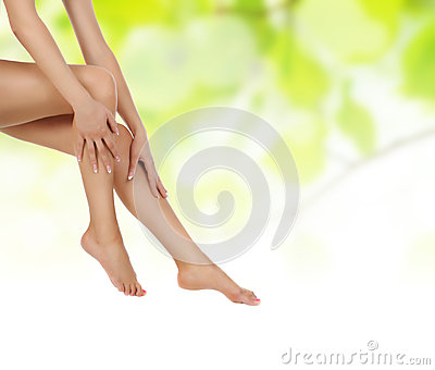 Legs over green being massaged with hands