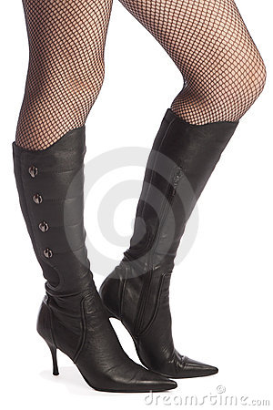 Legs in panty-hose and top-boots