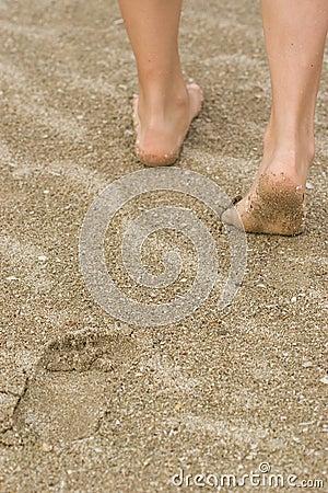 Legs in sand.