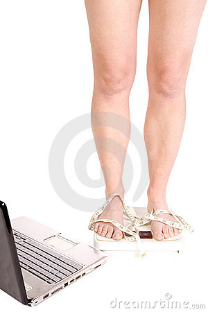 Legs on scales with tape and laptop