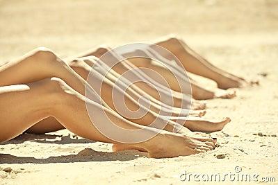 Legs of several girls