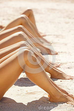 Legs of several girls