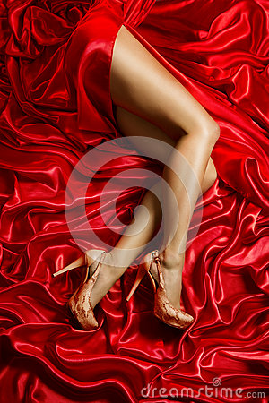 Free Legs Shoes High Heels On Red Cloth, Sexy Woman Silk Dress Fabric Royalty Free Stock Images - 56992269