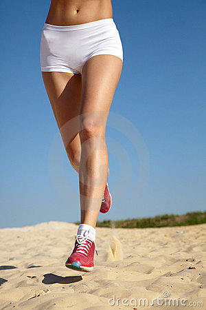 Legs of teenager running